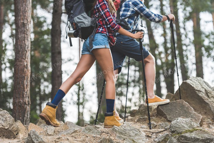 cropped shot of couple on hiking trip