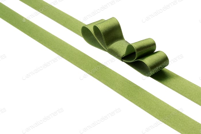 Festive green gift ribbon and bow isolated on white background