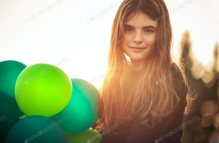 Cute girl with air balloons