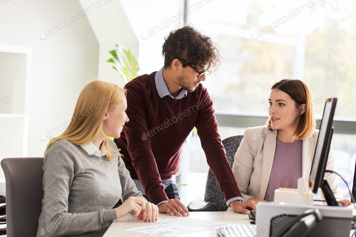 happy business team with papers in office