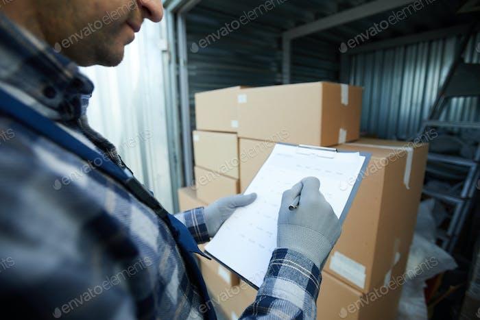 Busy cargo worker analyzing data