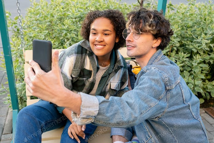 Affectionate teens communicating through video chat