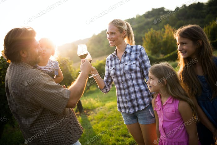 Picture of people tasting red wine in vineyard