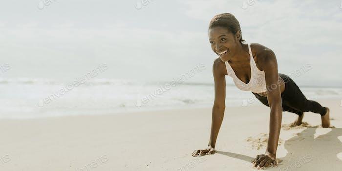 Beautiful woman planking