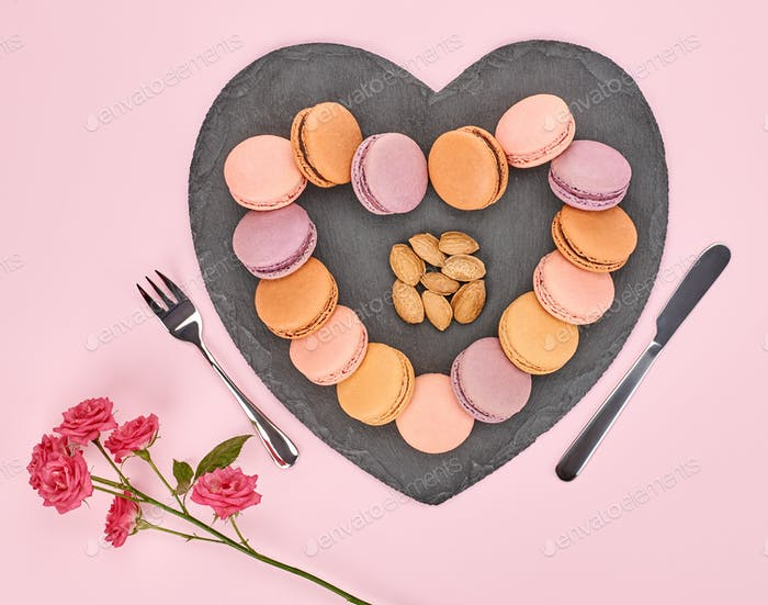Still life, macarons, heart shape. Table setting