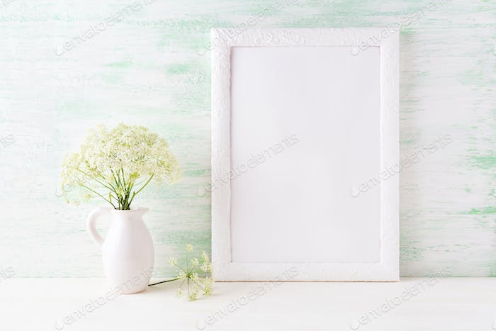 White frame mockup with delicate wild field flowers in pitcher