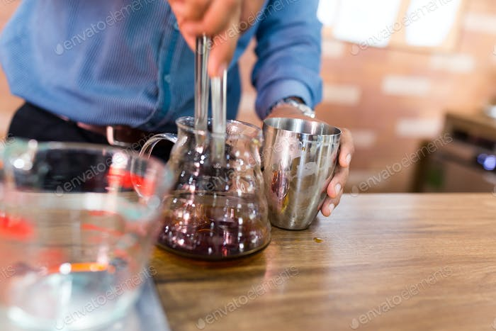 Barista making a drip coffee in cafe