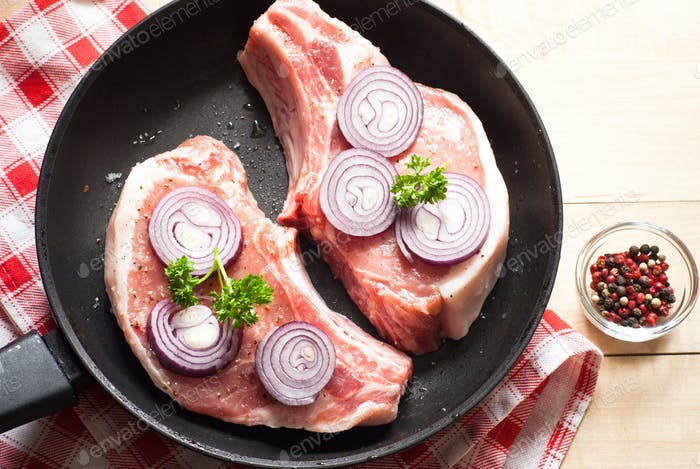 Raw pork  in a frying pan.