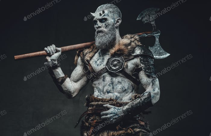 Pale skinned warrior with axe and horns in dark background
