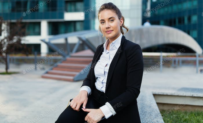 Beautiful businesswoman in business district