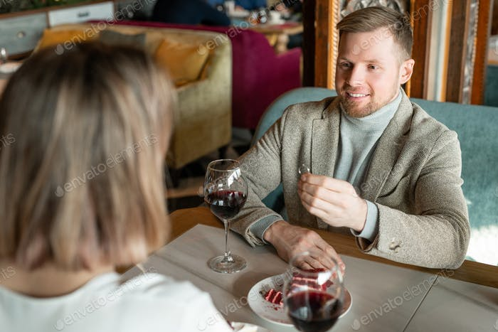 Happy young man with engagement ring making proposal to his girlfriend