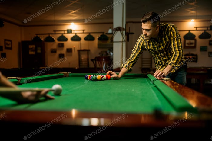 Two male billiard players leisures in poolroom