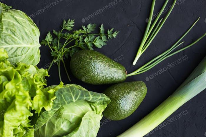 Fresh vegetables: cabbage, avocado, tomato, rosemary, garlic, mushrooms, leeks