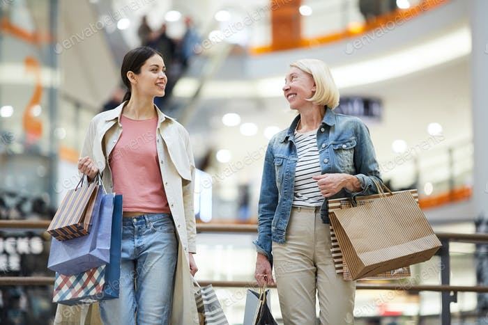 Cheerful women sharing expressions from shopping