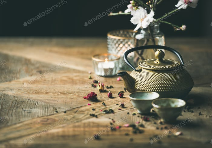 Traditional Asian tea ceremony arrangement over wooden background, copy space