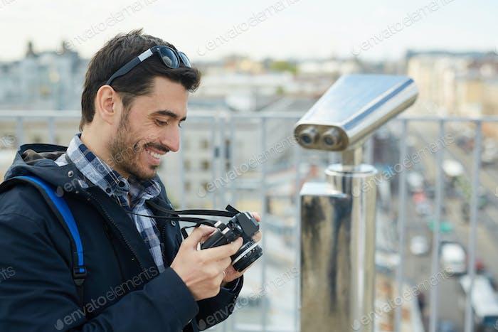 Tourist Looking at Camera Photos