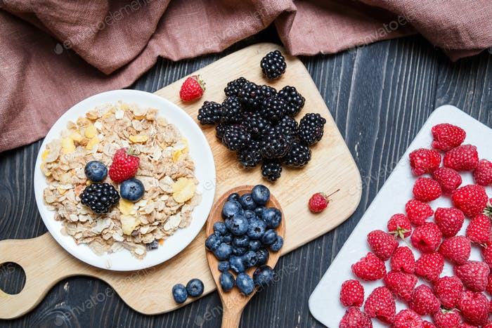 Cereal. Breakfast with muesli and berries. Top view, flat lay