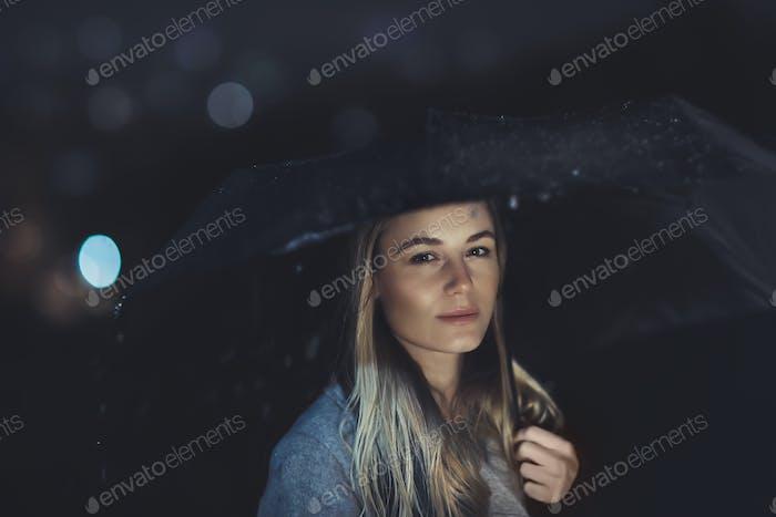 Beautiful woman at rainy night