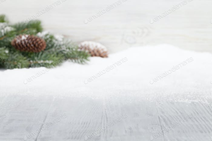 Christmas table backdrop with fir tree covered by snow