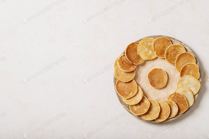 A stack of plain mini pancakes