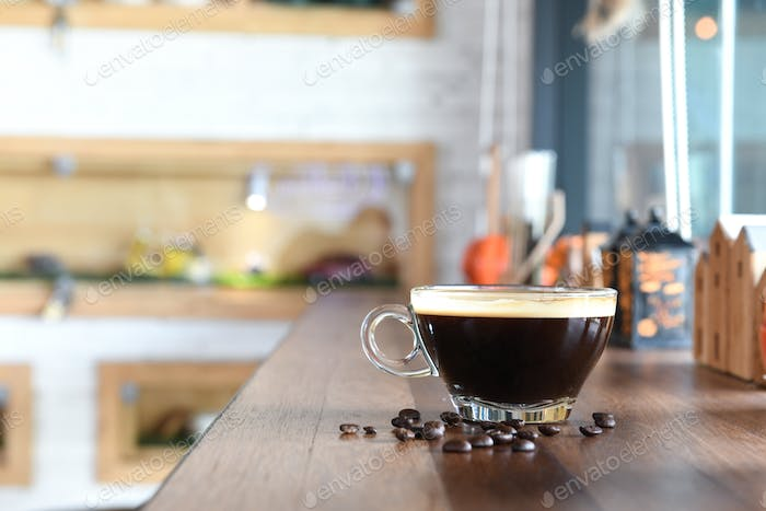 Coffee on wooden counter in cafe.