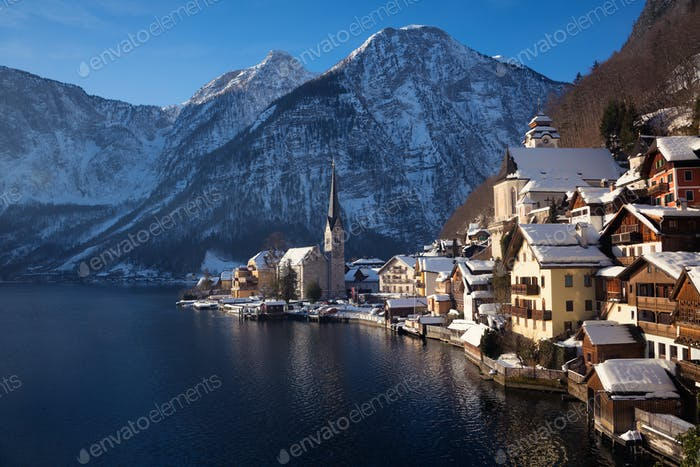 Hallstatt town with Alps mountains in the snow in winter