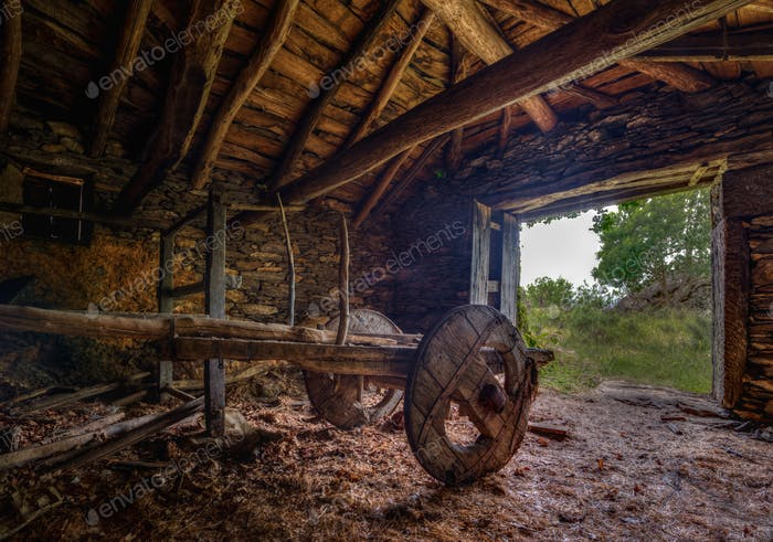 antique carriage in an old barn