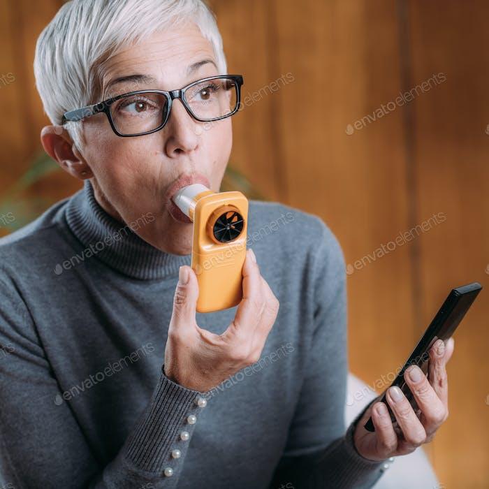 Spirometry. Using Digital Spirometer with Smart Phone App, Testing Lungs