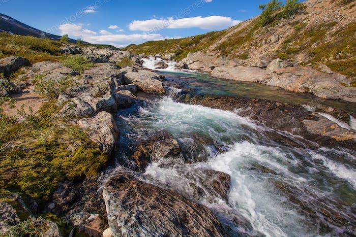 sunny landscape Norway mountains Dovrefjell river