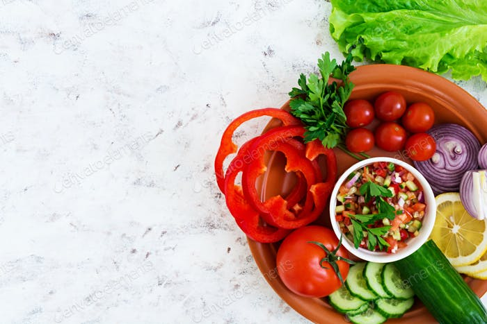 Salsa with ingredients on white background. Top view