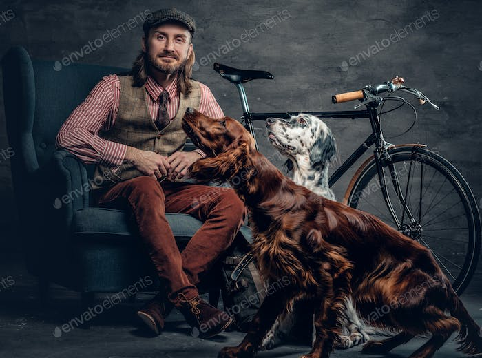 A man with dog and bicycle.