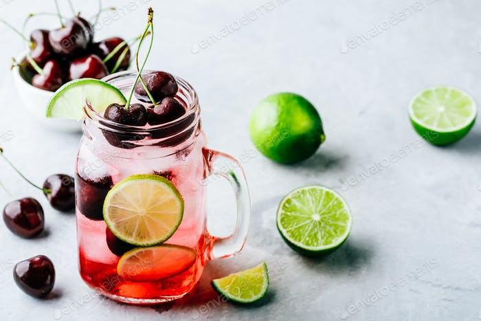 Cherry Limeade or Lemonade in glass mason jar. Ice cold summer drink.