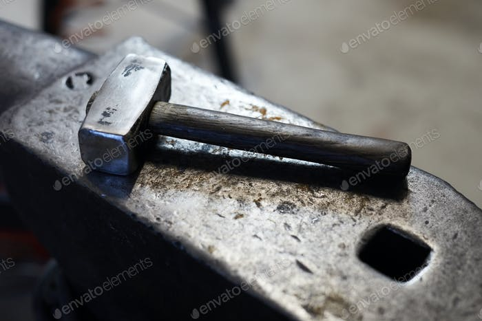 Blacksmiths hammer on anvil