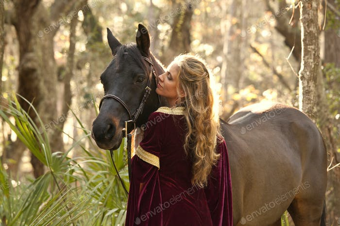 woman in medieval dress with horse