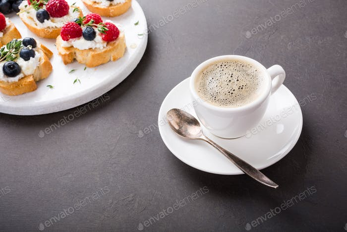 Cup of coffee with fruit sandwiches