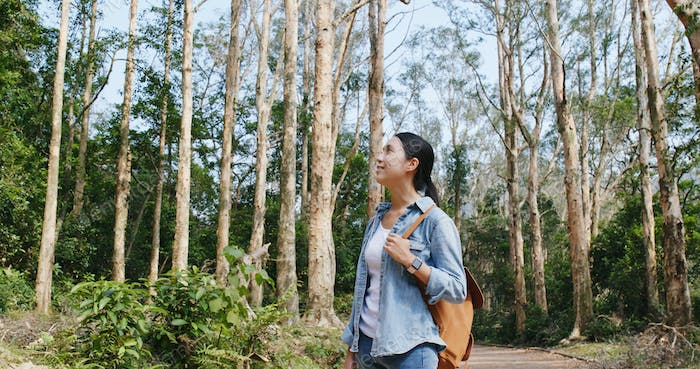 Woman enjoy hike in forest