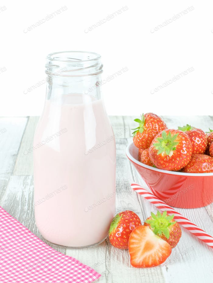 Strawberry Yogurt Milkshake on a Wooden Table.