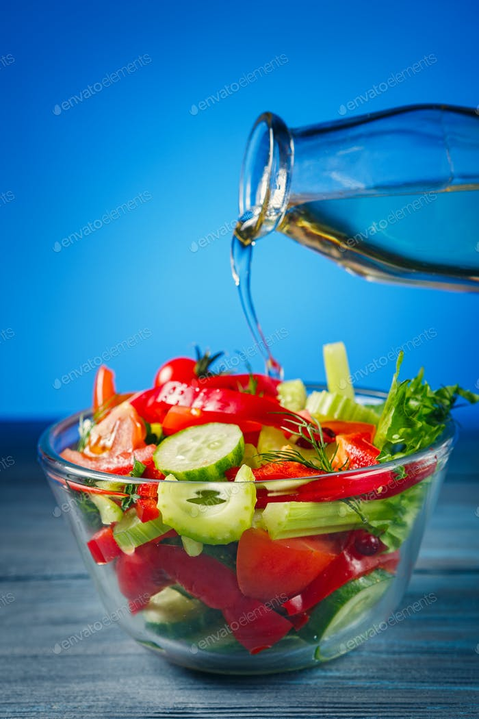 Salad with fresh vegetables and olive oil