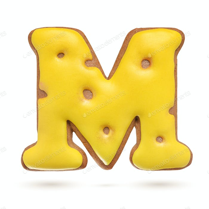 Capital letter M yellow gingerbread biscuit isolated on white.