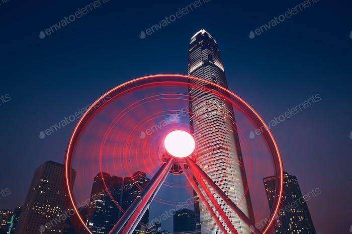 Observation Wheel against urban skyline