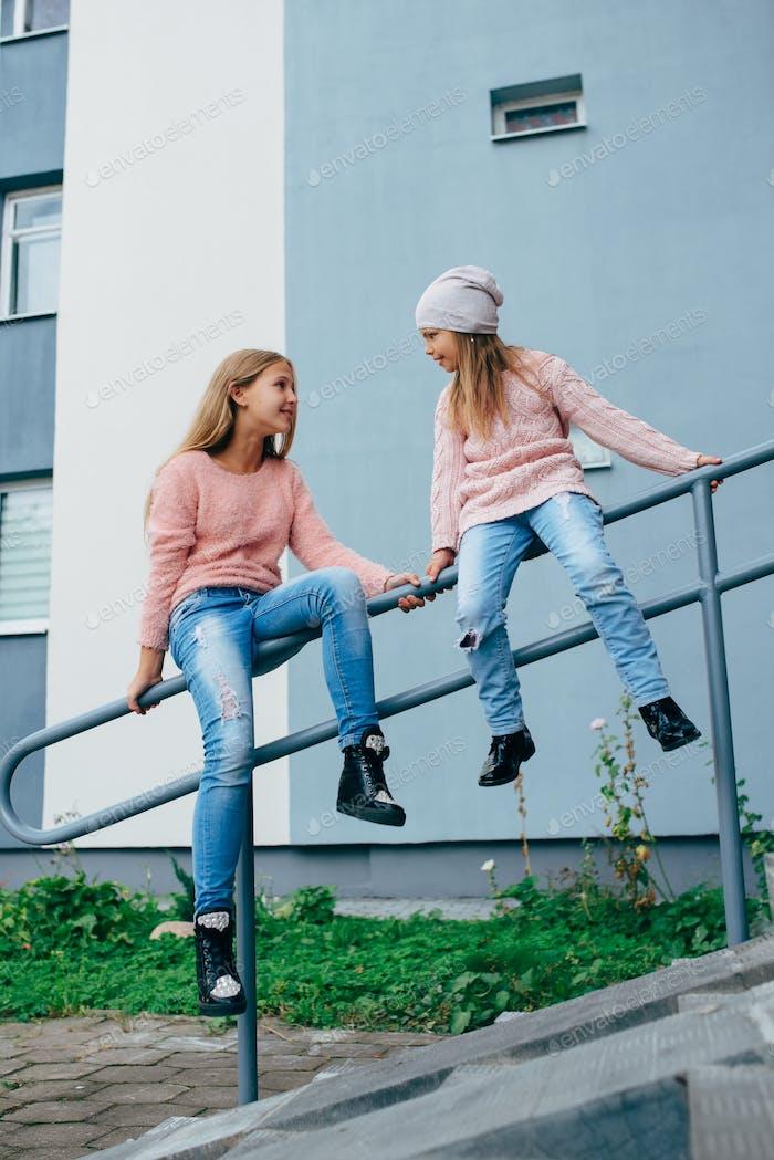 two beautiful girls on the street