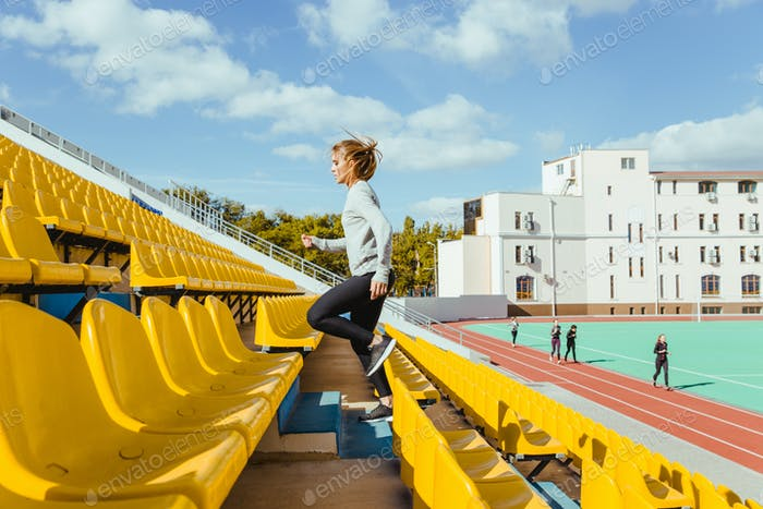 Sports woman running at stadium