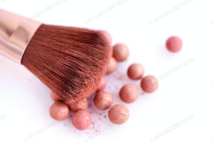 Cosmetic powder balls and makeup brush, isolated on white backgr