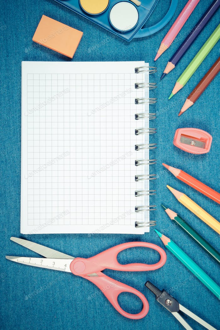 School and office supplies on jeans background, place for text