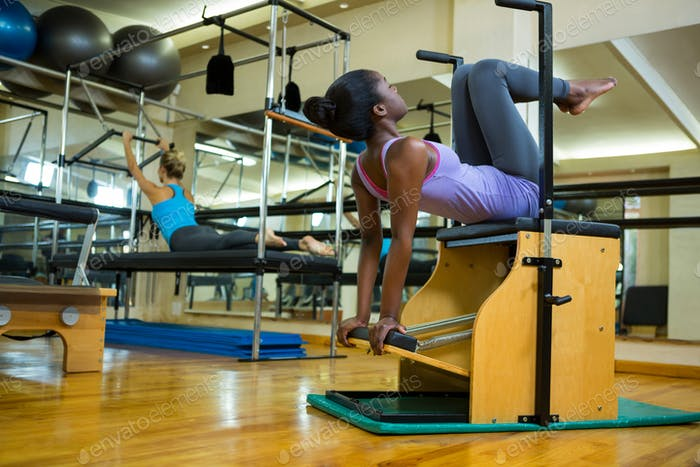 Woman exercising on wunda chair