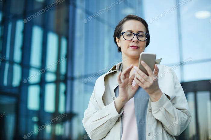 Busy woman checking email