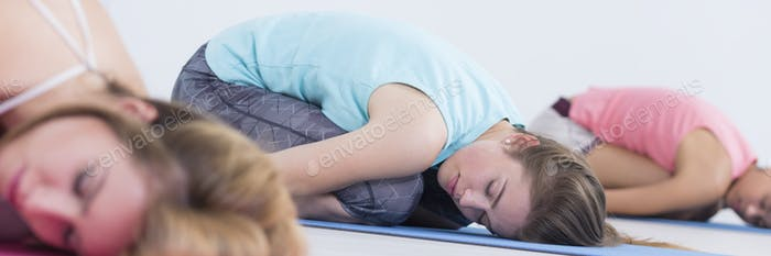 Relaxed women resting on mats