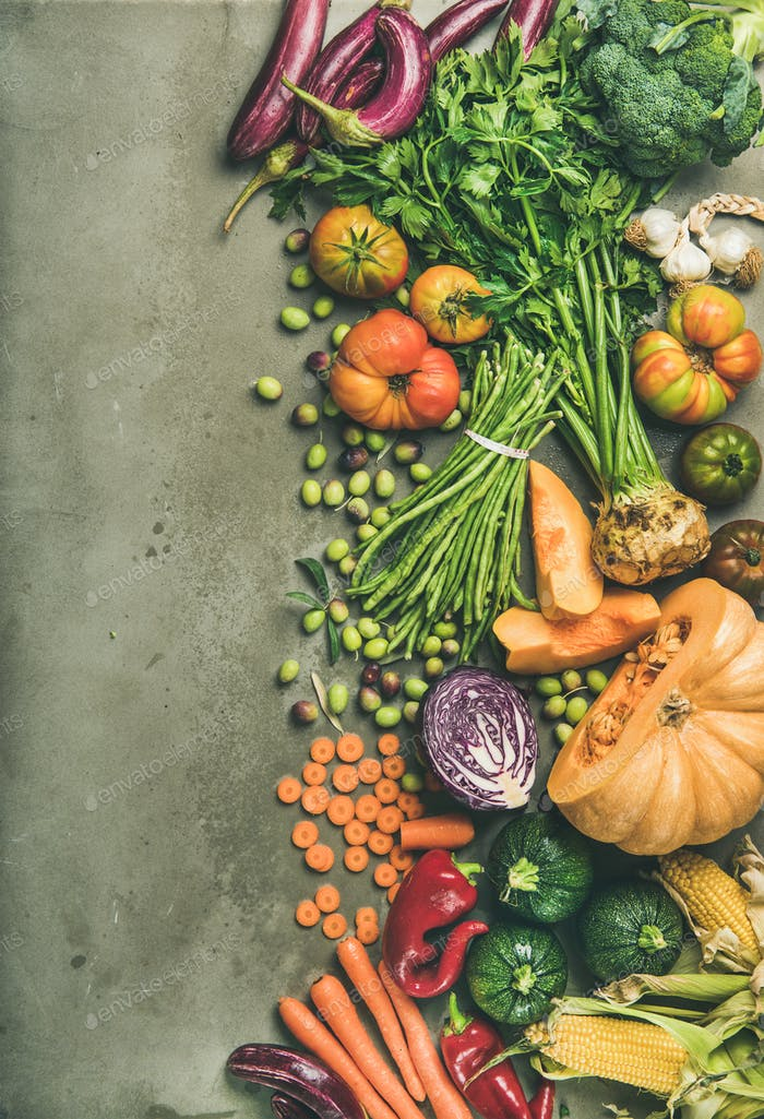 Healthy vegetarian Fall food cooking background over concrete table