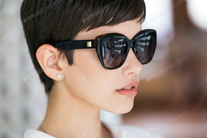 Beautiful young perfect model posing in fashion sunglasses
