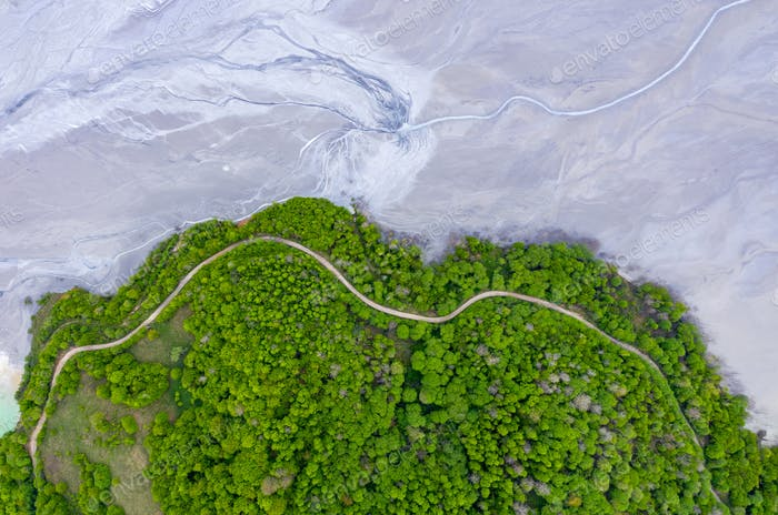 Aerial drone image of forest road and flooding mining residuals